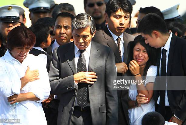Yesenia Mendoza becomes emotional as she walks in the funeral procession of her boyfriend US Marine Sgt Ronald A Rodriguez with Rodriguez's parents...