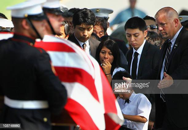 Yesenia Mendoza becomes emotional as she watches the flagdraped casket of her boyfriend US Marine Sgt Ronald A Rodriguez pass by during his funeral...