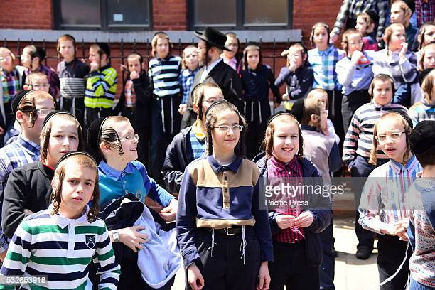 Yeshiva students gather outside school to watch proceeding Hundreds of Satmar Hasidim filled the streets of Williamsburg to mourn the sudden death of...