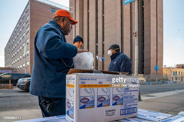 Yeshiva University employees unload a pallet of bleach cleaner on March 4 2020 in New York City A Yeshiva student has tested positive for Covid19 The...