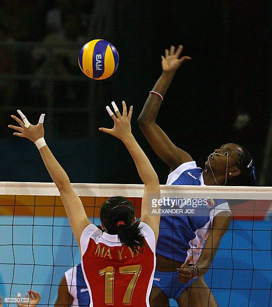 Yessica Paz Hidalgo of Venezuela in action against China's Yunwen Ma during a Preliminary Pool A Women's Volleyball match at the Beijing Institute of...