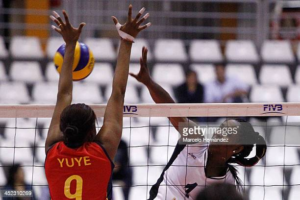 Yessica Paz of Venezuela plays the ball against Romana Yuranny of Colombia during women's volleyball as part of the XVII Bolivarian Games Trujillo...