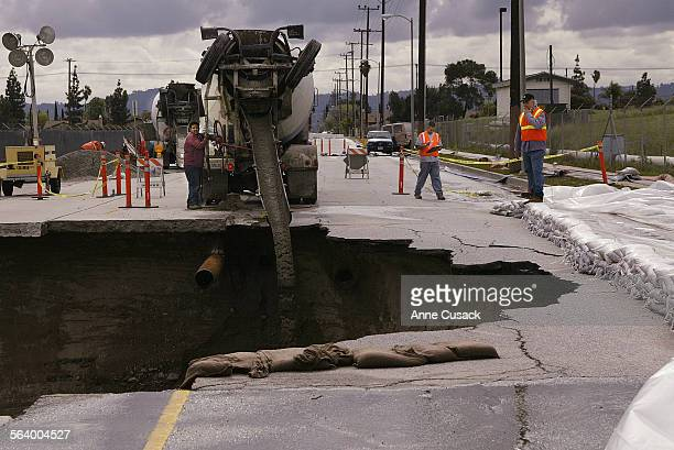 Yesterday morning's heavy rains and possibly a broken sewer line caused a sink hole which is about 30 feet deep and 50 x 100 feet in the 8400 block...