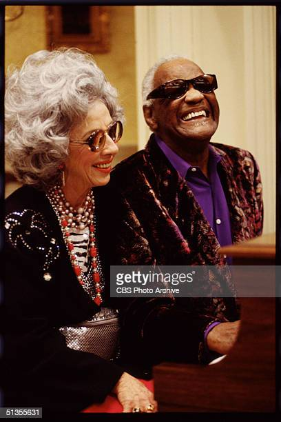 Yetta portrayed by American actress Ann Morgan Guilbert sits at the piano with Sammy Portnoy portrayed by American singer Ray Charles in a scene from...