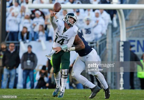 Yetur GrossMatos of the Penn State Nittany Lions hurries Brian Lewerke of the Michigan State Spartans on October 13 2018 at Beaver Stadium in State...