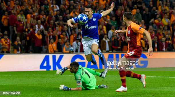 Yeven Konoplyanka of Schalke challenges Fernando Muslera of Galatasaray during the Group D match of the UEFA Champions League between Galatasaray and...
