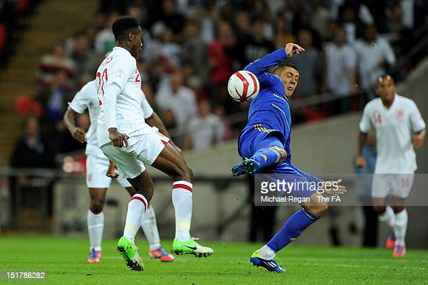 Yevgen Khacheridi of Ukraine commits handball to concede a late penalty to England during the FIFA 2014 World Cup qualifier group H match between...