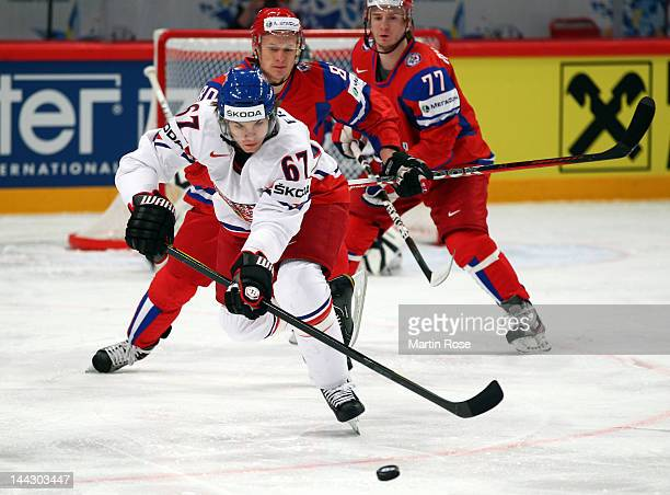 Yevgeni Ketov of Russia and Michael Frolik of Czech Republic battle for the puck during the IIHF World Championship group S match between Russia and...
