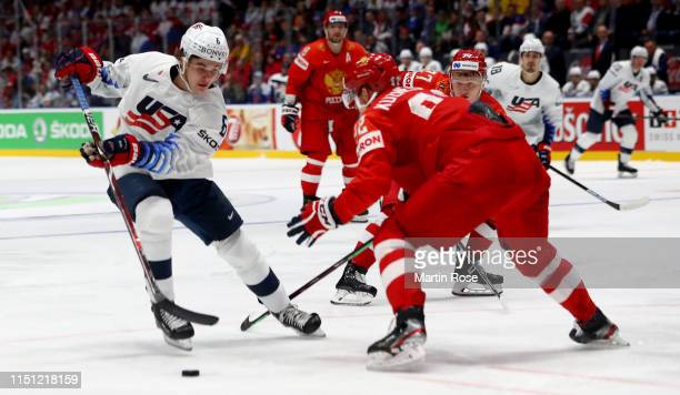 Yevgeni Kuznetsov of Russia challenges Jack Hughes of United States during the 2019 IIHF Ice Hockey World Championship Slovakia quarter final game...
