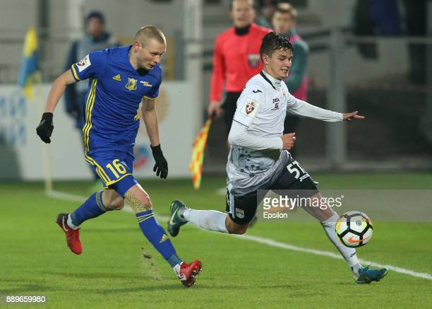 Yevgeni Makeyev of FC Rostov RostovonDon vies for the ball with Vyacheslav Krotov of FC Ufa during the Russian Premier League match between FC Rostov...