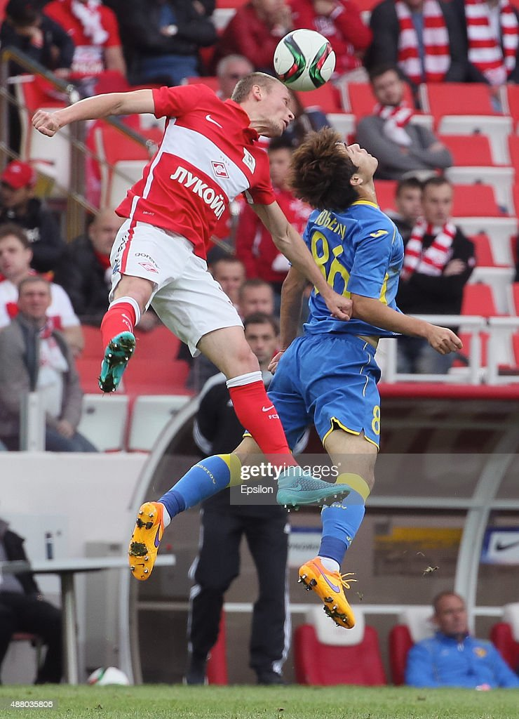 Yevgeni Makeyev of FC Spartak Moscow challenged by Yoo Byung-Soo of FC Rostov Rostov-on-Don during the Russian Premier League match between FC Spartak Moscow v FC Rostov Rostov on Don at the Arena Otkritie stadium on September 13, 2015 in Moscow, Russia.