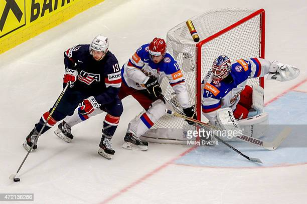 Yevgeni Malkin of Russia and Nick Bonino of USA battle for the puck during the IIHF World Championship group B match between Russia and USA at CEZ...