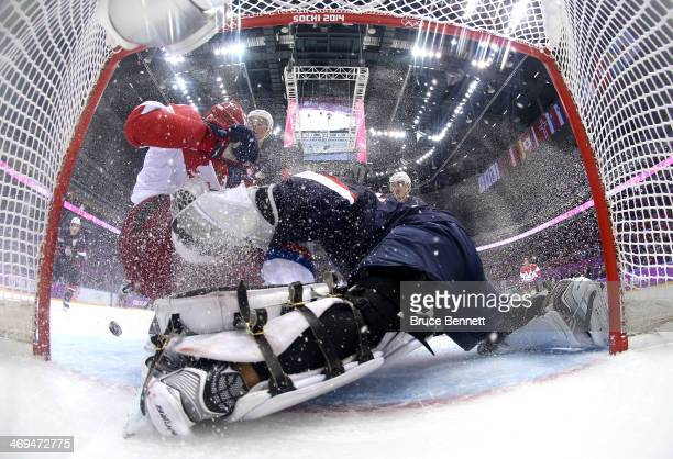 Yevgeni Malkin of Russia attempts to score a goal against Jonathan Quick of the United States during the Men's Ice Hockey Preliminary Round Group A...