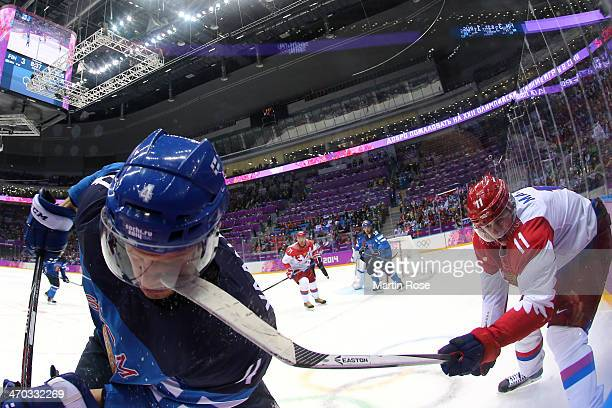 Yevgeni Malkin of Russia hits Ossi Vaananen of Finland with his stick during the Men's Ice Hockey Quarterfinal Playoff on Day 12 of the 2014 Sochi...