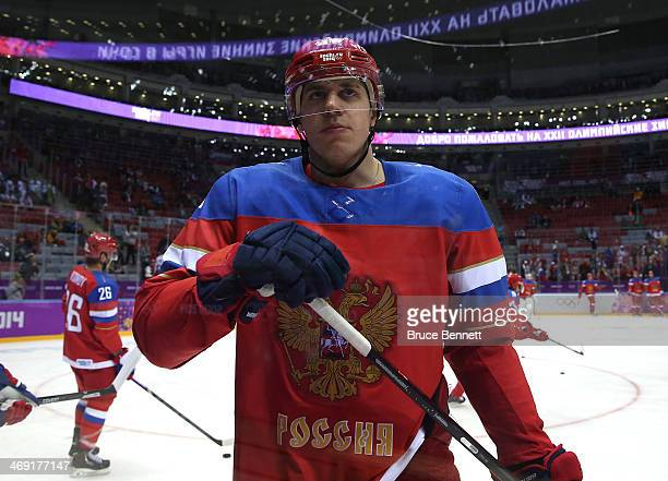Yevgeni Malkin of Russia looks on against Slovenia during the Men's Ice Hockey Preliminary Round Group A game on day six of the Sochi 2014 Winter...