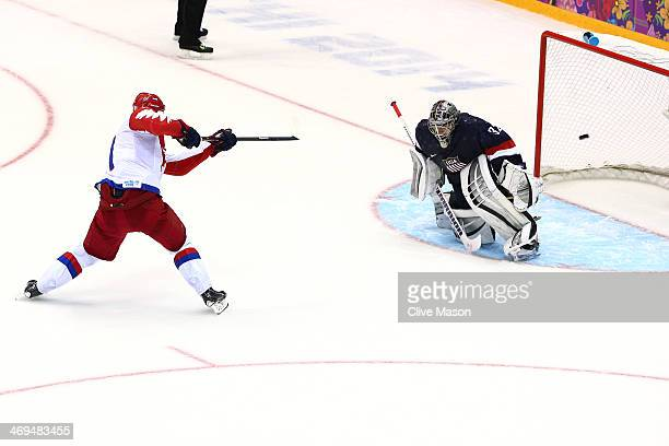 Yevgeni Malkin of Russia scores on a shootout against Jonathan Quick of the United States during the Men's Ice Hockey Preliminary Round Group A game...
