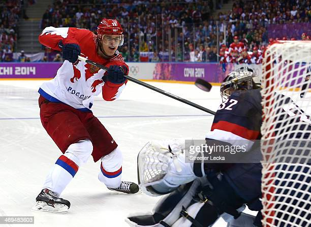 Yevgeni Malkin of Russia shoots during a shootout against Jonathan Quick of the United States during the Men's Ice Hockey Preliminary Round Group A...