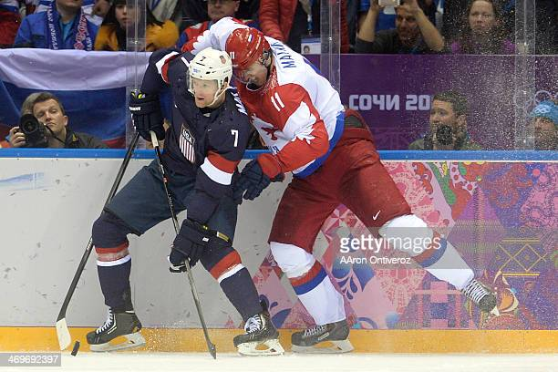 Yevgeni Malkin of the Russia skates into the back of Paul Martin of the U.S.A. During the third period of the U.S.A.'s shootout-win at Bolshoy arena....