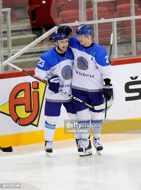Yevgeni Rymarev of Kazakhstan celebrates his goal with Roman Starchenko of Kazakhstan during the 2018 IIHF Ice Hockey World Championship Division I...