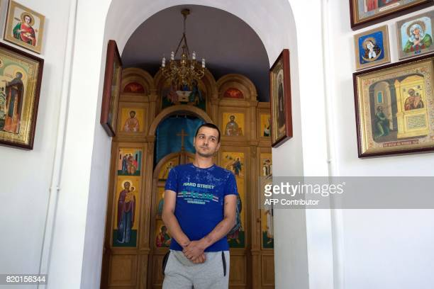 Yevgeniy a drug user stands in a church of the toxicology unit in a hospital treating drug users in the rebel capital of Donetsk on July 11 2017...