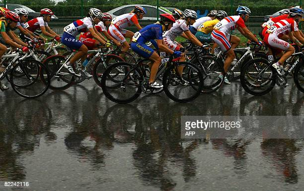 Yevgeniya Vysotska of Ukraine rides with the pack during the women's road cycling event of the Beijing 2008 Olympic Games, near Beijing on August 10,...