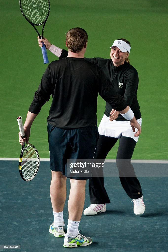 Yevgeny Kafelnikov and Vera Zvonareva celebrate during their doubles match against Venus Williams and John McEnroe of the USA on day two of the Hong Kong Tennis Classic at the Victoria stadium on January 6, 2011 in Hong Kong, China.