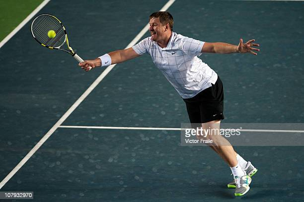 Yevgeny Kafelnikov in action during his doubles match with Maria Kirilenko of Russia against Aravane Rezai of France and Stefan Edberg of Sweden...