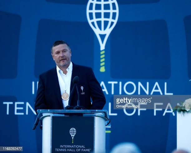Yevgeny Kafelnikov looks on during his speech after being inducted with the Class of 2019 in to the International Tennis Hall of Fame on July 20 2019...