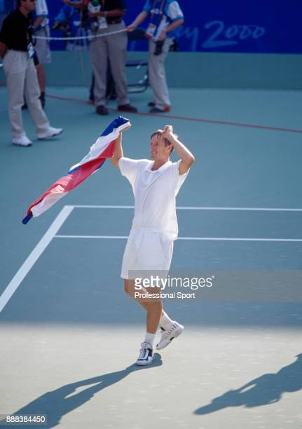 Yevgeny Kafelnikov of Russia celebrates winning the gold medal after defeating Tommy Haas of Germany in the Men's Singles Gold Medal match in the...