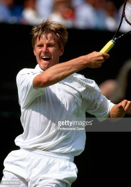 Yevgeny Kafelnikov of Russia in action during a men's singles match at the Wimbledon Lawn Tennis Championships in London circa June 1996 Kafelnikov...