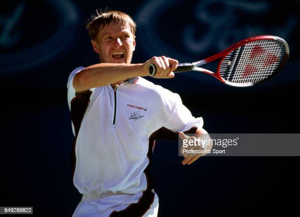 Yevgeny Kafelnikov of Russia in action during a men's singles match at the Australian Open Tennis Championships in Melbourne circa January 2000...