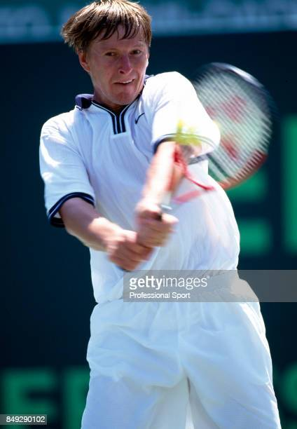 Yevgeny Kafelnikov of Russia in action during a men's singles match at the Ericsson Open Tennis Championships in Key Biscayne Florida circa April...