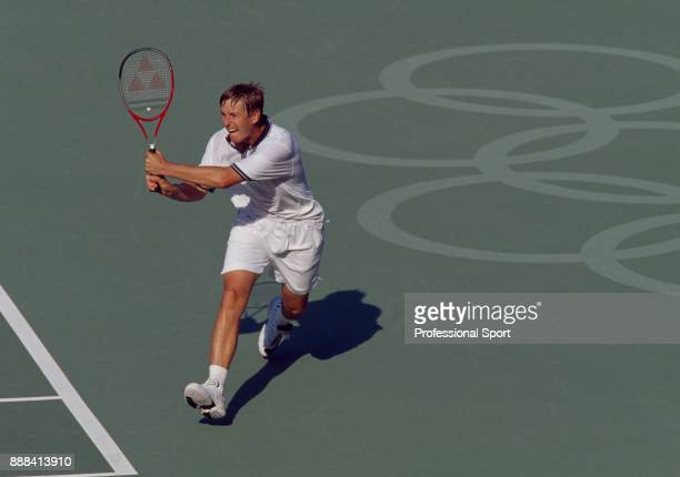 Yevgeny Kafelnikov of Russia in action during a Men's Singles match in the tennis event at the Summer Olympic Games at the NSW Tennis Centre in...