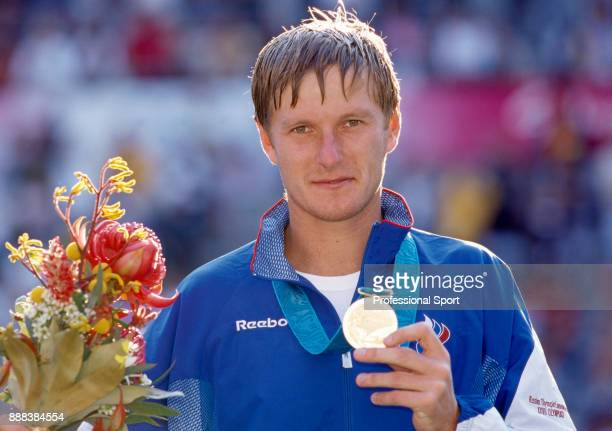 Yevgeny Kafelnikov of Russia poses with the gold medal after defeating Tommy Haas of Germany in the Men's Singles Gold Medal Match in the tennis...