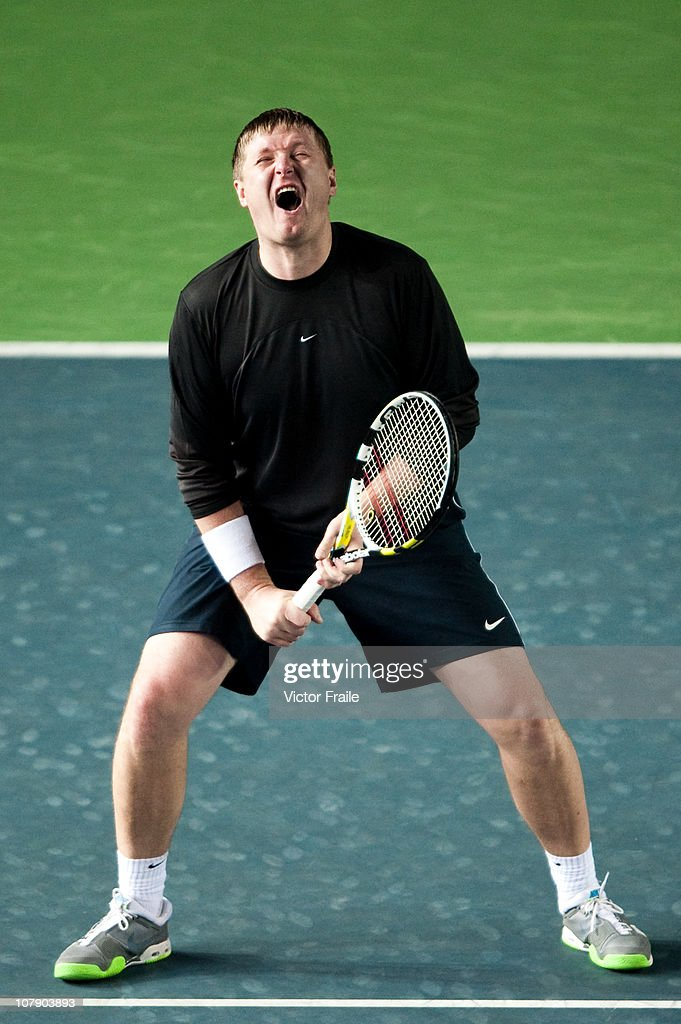 Yevgeny Kafelnikov of Russia reacts during his doubles match with Vera Zvonareva against Venus Williams and John McEnroe of the USA on day two of the Hong Kong Tennis Classic at the Victoria stadium on January 6, 2011 in Hong Kong, China.