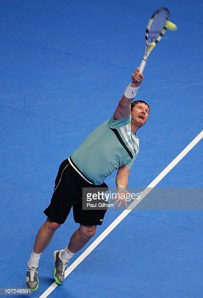 Yevgeny Kafelnikov of Russia serves during the match between Greg Rusedski and Yevgeny Kafelnikov on day three of the AEGON Masters 2010 at the Royal...