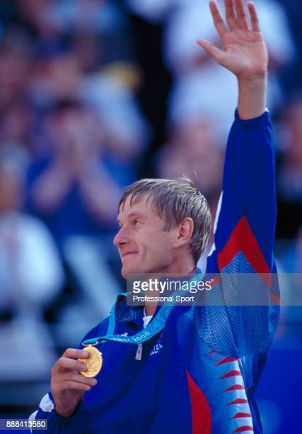 Yevgeny Kafelnikov of Russia waves to the crowd with his gold medal after defeating Tommy Haas of Germany in the Men's Singles Gold Medal Match in...