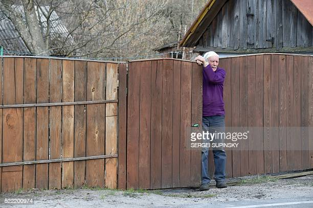 Yevgeny Markevich looks out from the gate of his yard in Chernobyl on April 8 2016 The sturdy 78yearold former teacher is among 158 people still...