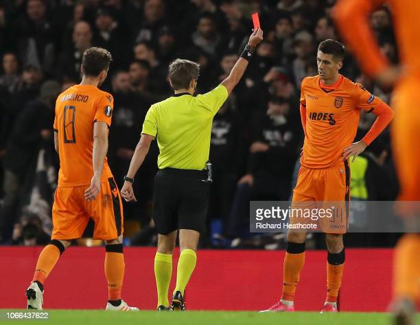Yevhen Khacheridi of PAOK FC is shown a red card by referee Kristo Tohver during the UEFA Europa League Group L match between Chelsea and PAOK at...