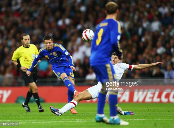 Yevhen Konoplianka of Ukraine shoots past Steven Gerrard of England to score their first goal with during the FIFA 2014 World Cup Group H qualifying...