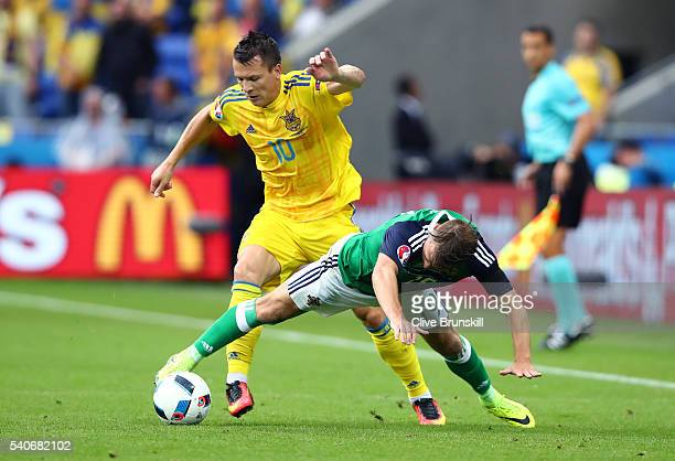 Yevhen Konoplyanka and Jamie Ward of Northern Ireland compete for the ball during the UEFA EURO 2016 Group C match between Ukraine and Northern...