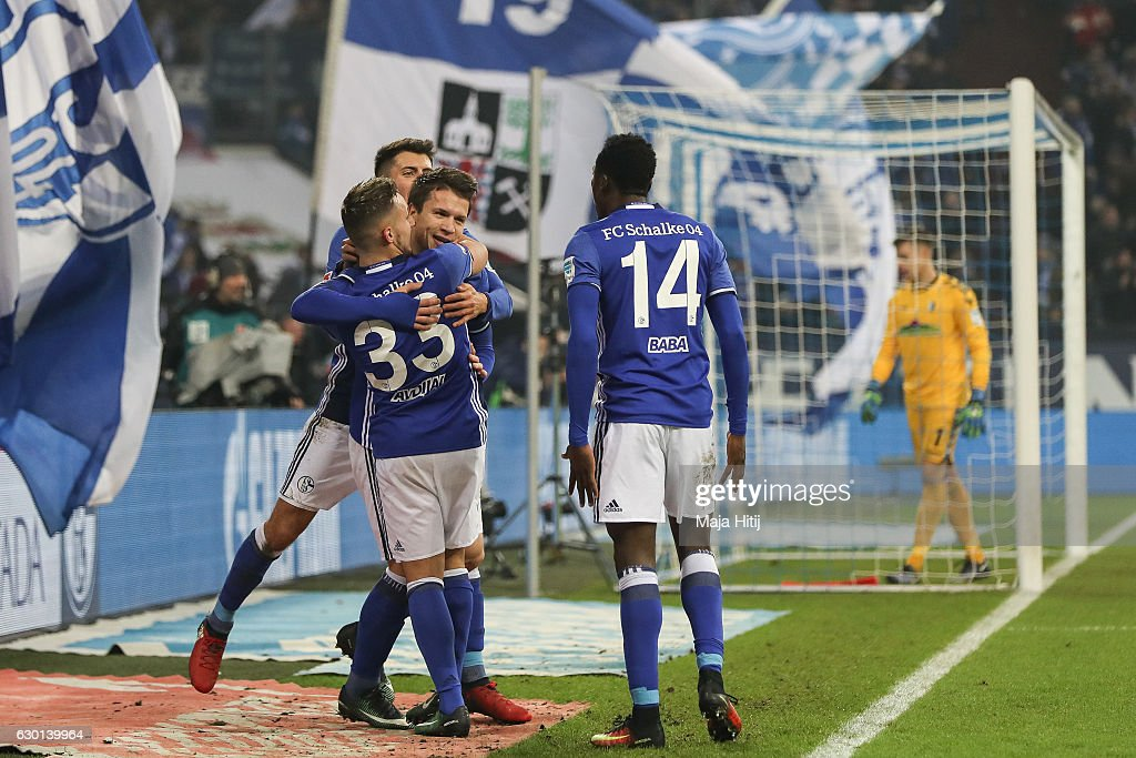 Yevhen Konoplyanka celebrates with his team-mates after scoring the equalizing goal to make it 1-1 during the Bundesliga match between FC Schalke 04 and SC Freiburg at Veltins-Arena on December 17, 2016 in Gelsenkirchen, Germany.