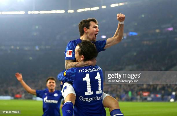 Yevhen Konoplyanka of FC Schalke 04 celebrates scoring his sides first goal with Benito Raman of FC Schalke 04 during the Bundesliga match between FC...