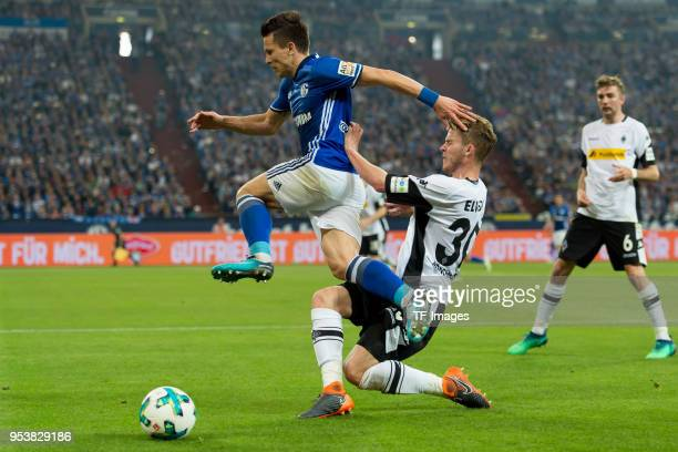 Yevhen Konoplyanka of Schalke and Nico Elvedi of Moenchengladbach battle for the ball during the Bundesliga match between FC Schalke 04 and Borussia...