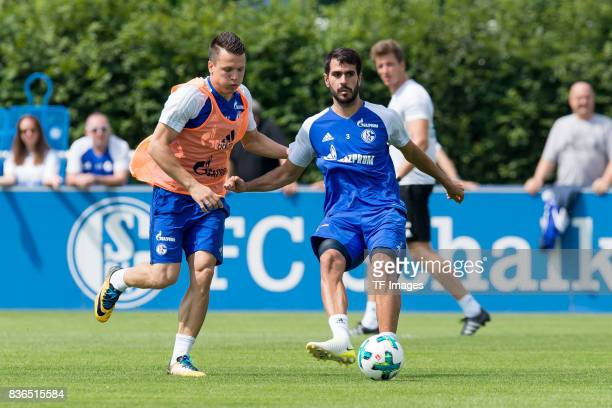 Yevhen Konoplyanka of Schalke and Pablo Insua of Schalke battle for the ball during a training session at the FC Schalke 04 Training center on July 5...