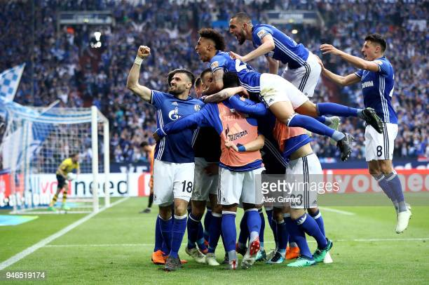 Yevhen Konoplyanka of Schalke celebrate with his team mates after he scores the opening goal during the Bundesliga match between FC Schalke 04 and...
