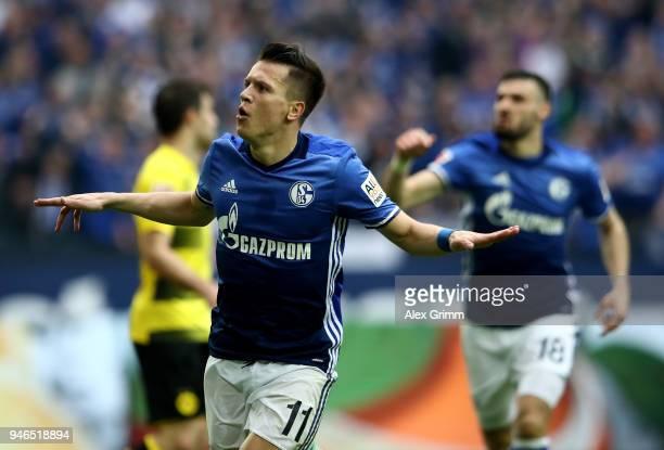 Yevhen Konoplyanka of Schalke celebrates after he scores the opening goal during the Bundesliga match between FC Schalke 04 and Borussia Dortmund at...