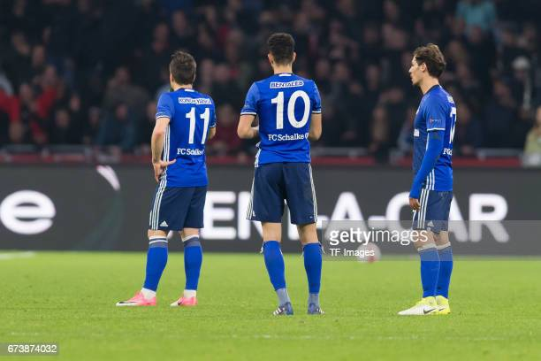 Yevhen Konoplyanka of Schalke Nabil Bentaleb of Schalke and Benjamin Stambouli of Schalke looks dejected during the UEFA Europa League Quarter Final...