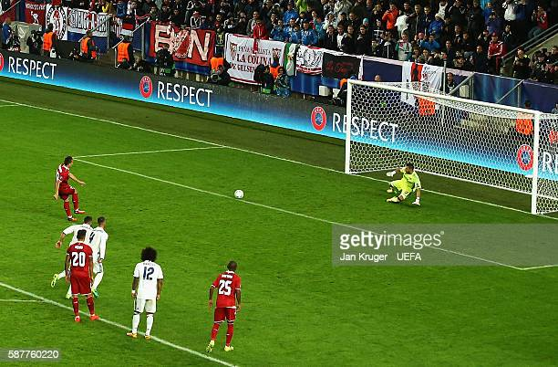 Yevhen Konoplyanka of Sevilla scores from the penalty spot for his team's second goal during the UEFA Super Cup match between Real Madrid and Sevilla...