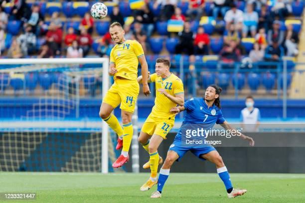 Yevhen Makarenko of Ukraine, Mykola Matviyenko of Ukraine and Marios Ilia of Cyprus battle for the ball during the international friendly match...